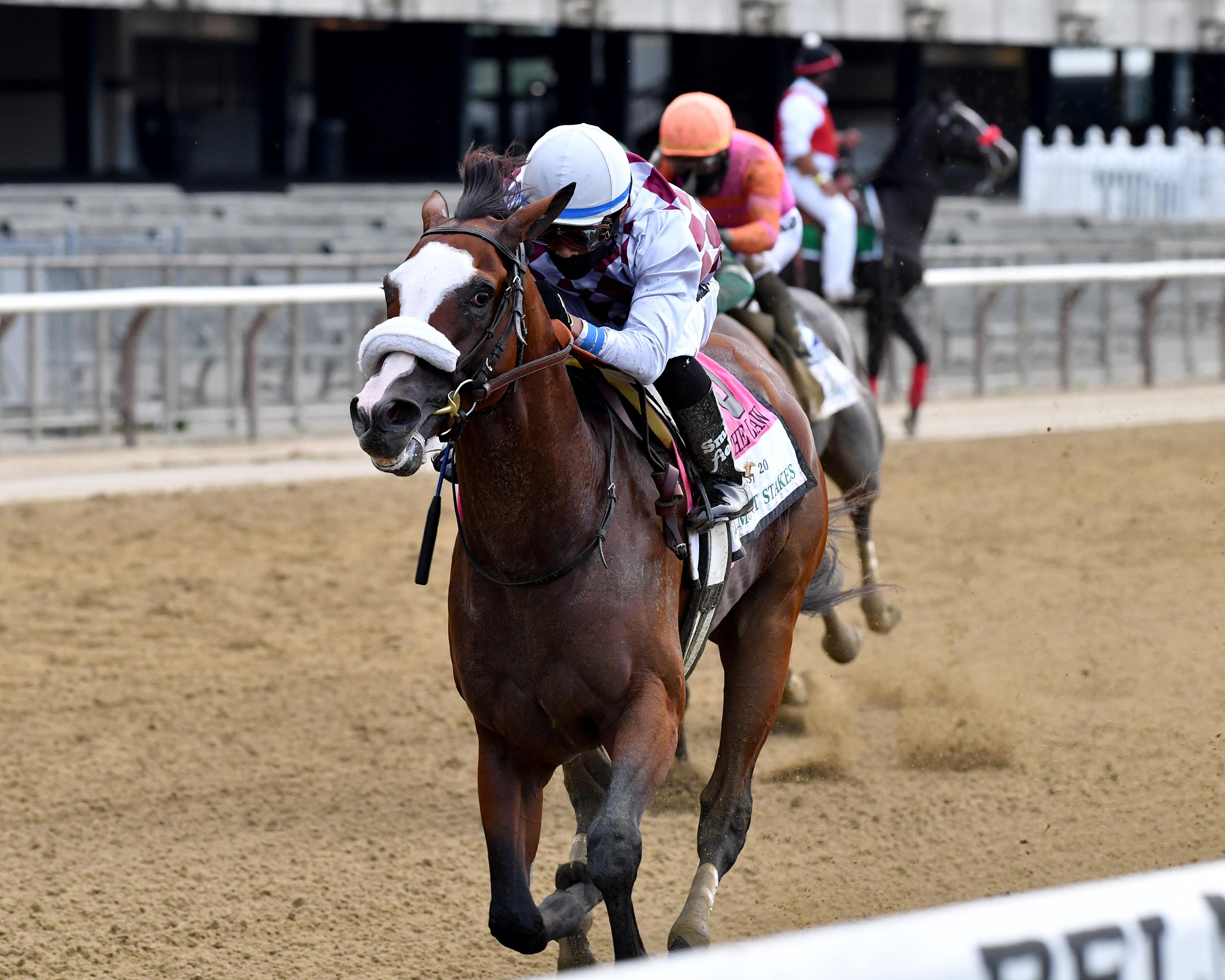 Tiz the Law streaks to victory in the Belmont.