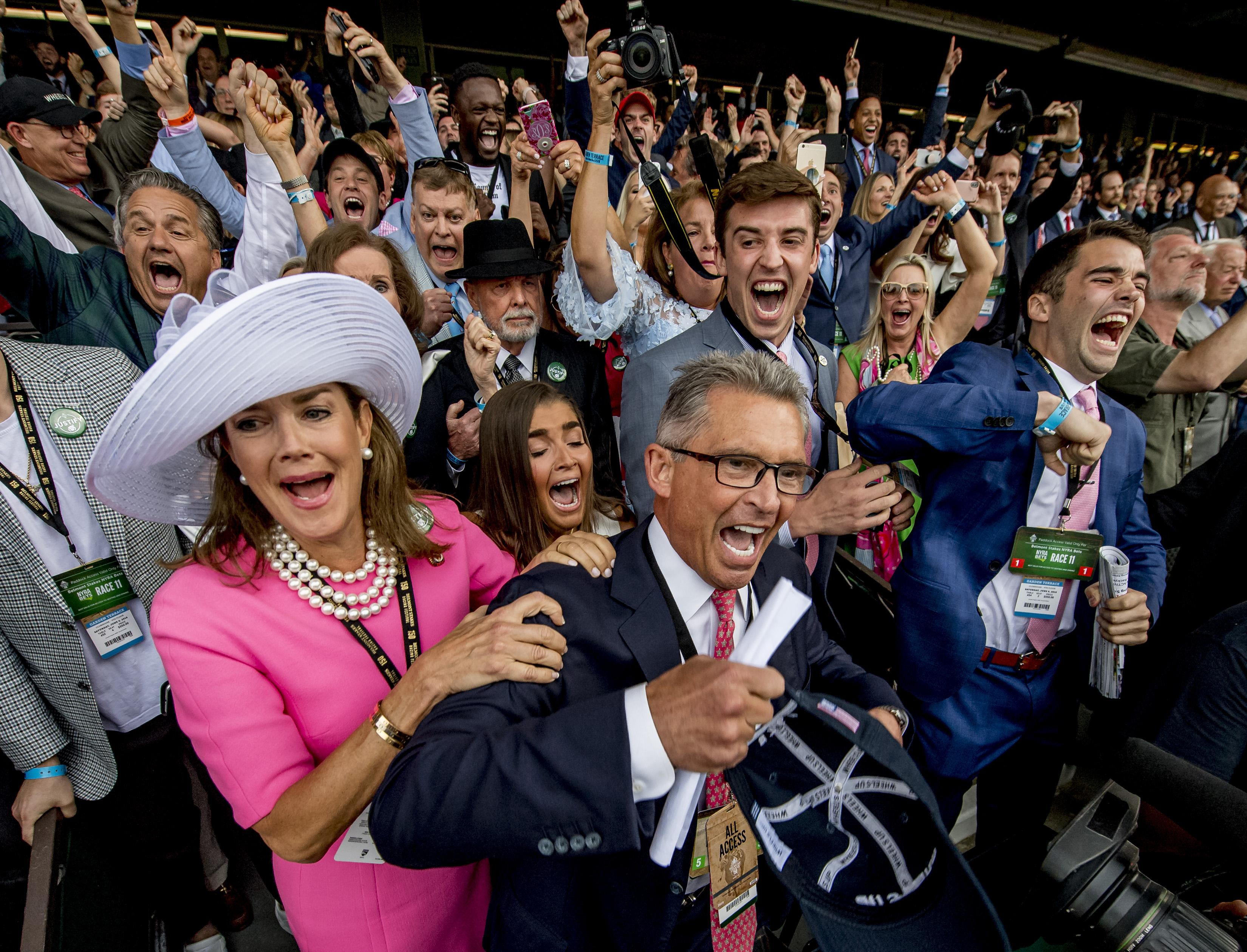 Kenny Troutt celebrates Justify's Belmont win with family and friends.