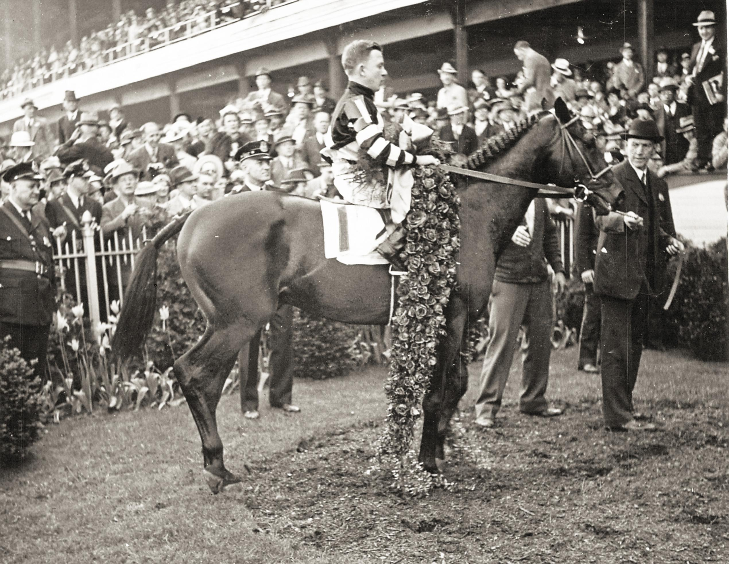 War Admiral after winning the 1937 Kentucky Derby.