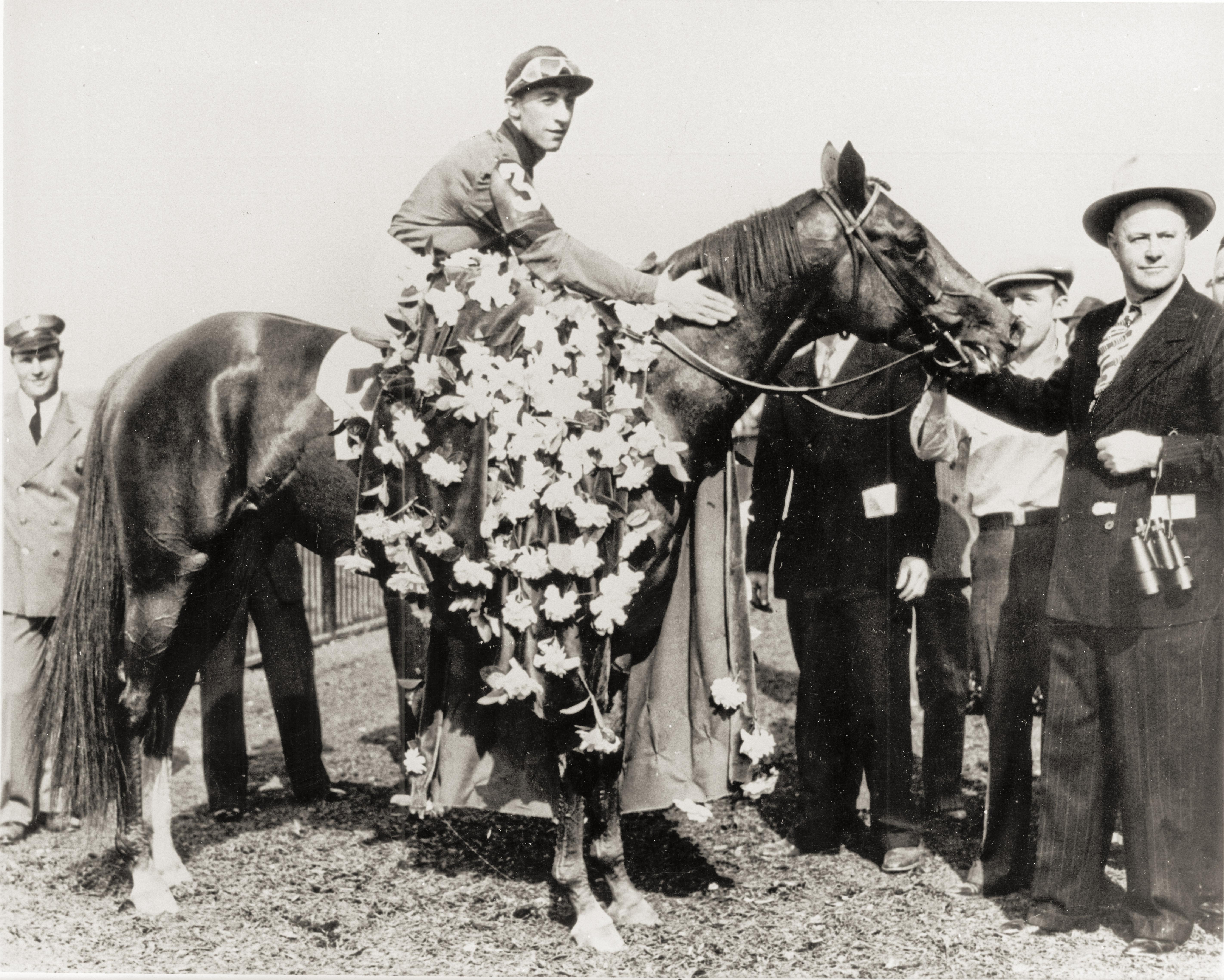 Arcaro with Whirlaway in the Belmont Stakes winner's circle.