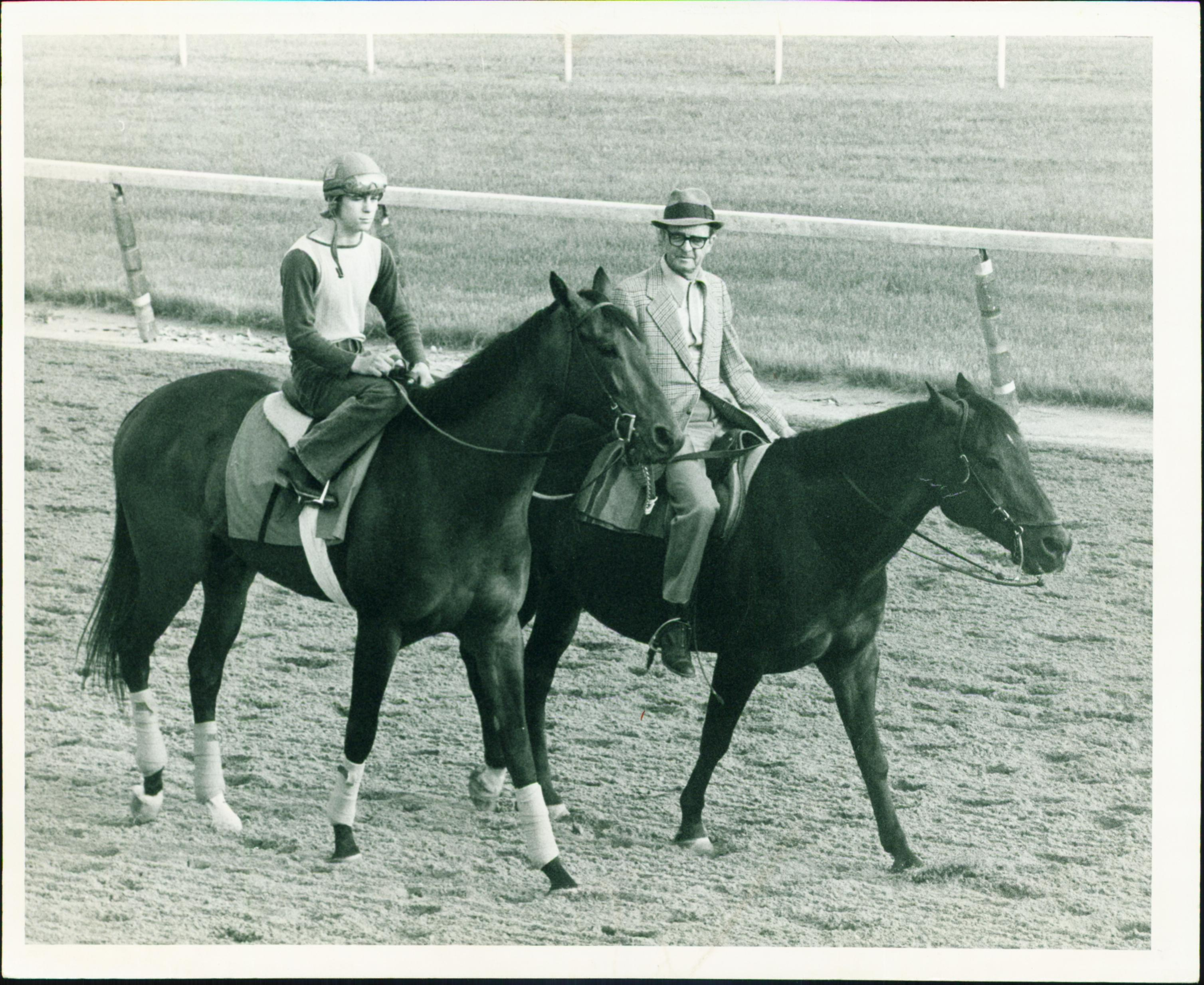 Woody Stephens, right, with his 1974 Kentucky Derby winner Cannonade.