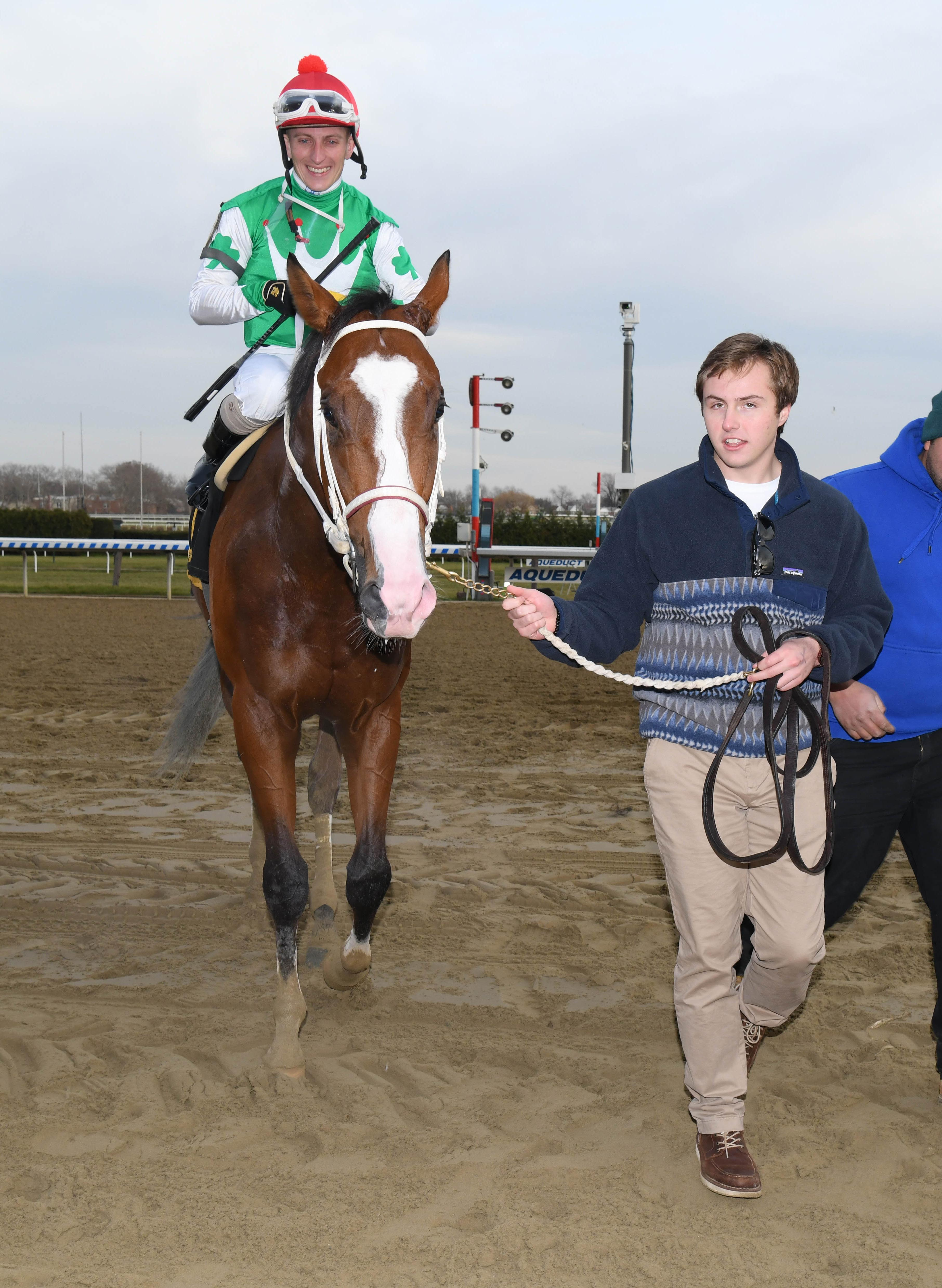 Zacney leads Maximus Mischief into the Remsen winner's circle.
