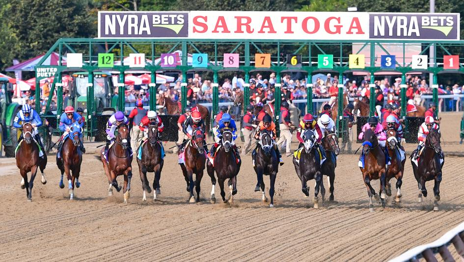 The Field For 2017 Travers Stakes Breaks From Gate With Eventual Winner West Coast Third Right Pink Jockey Silks Taking An Early Lead
