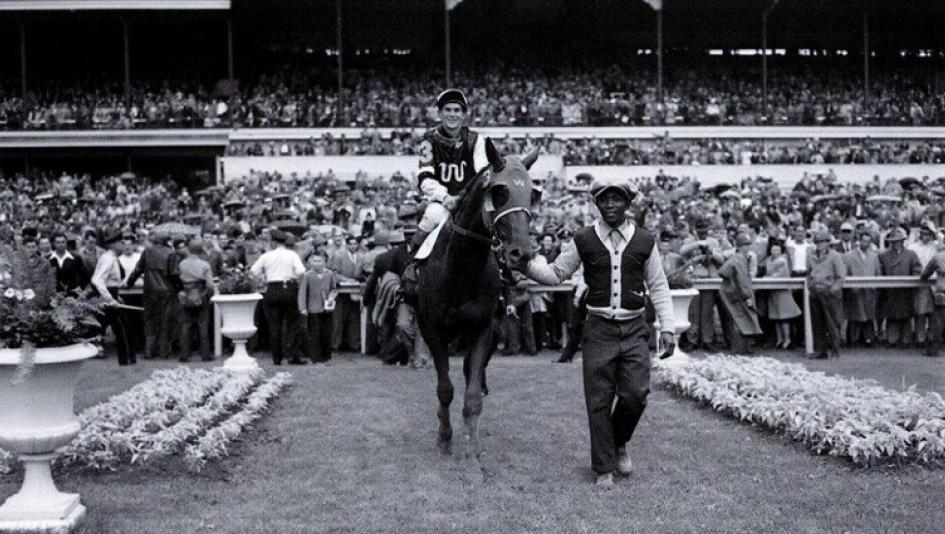 Assault is led into the winner's circle after winning the 1946 Kentucky Derby.