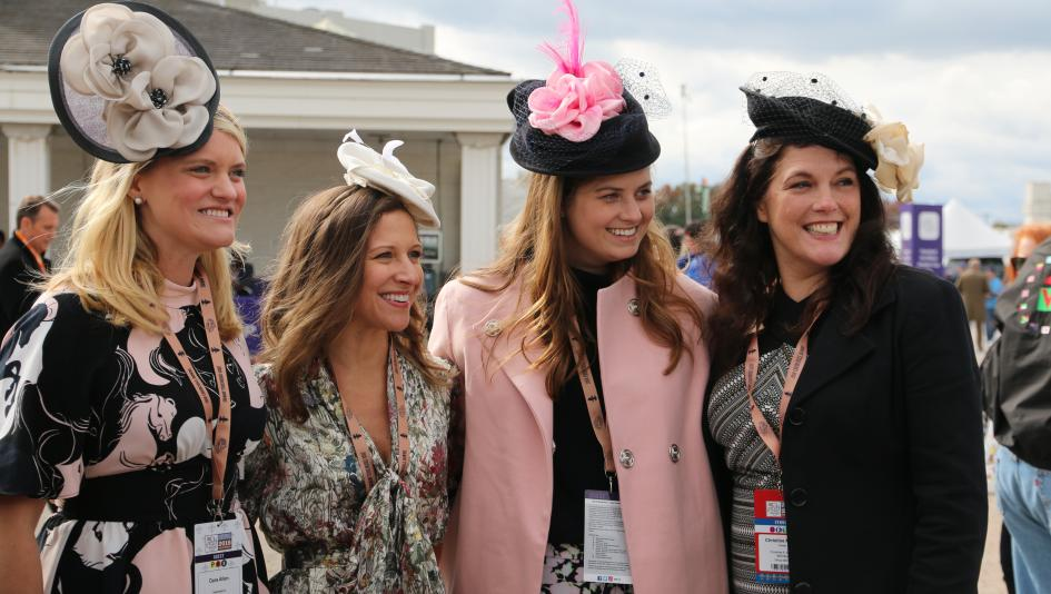 Fans enjoy the Breeders' Cup races on Friday at Churchill Downs.