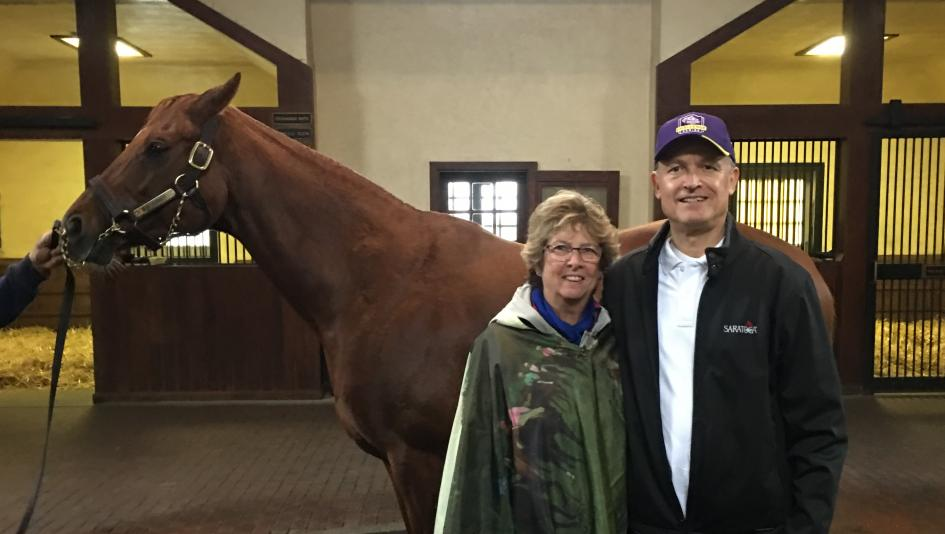 Racing fans Rita and Bob Kasinow, pictured with 2017 Horse of the Year Gun Runner, are the grand prize winners of Equestricon 2018.