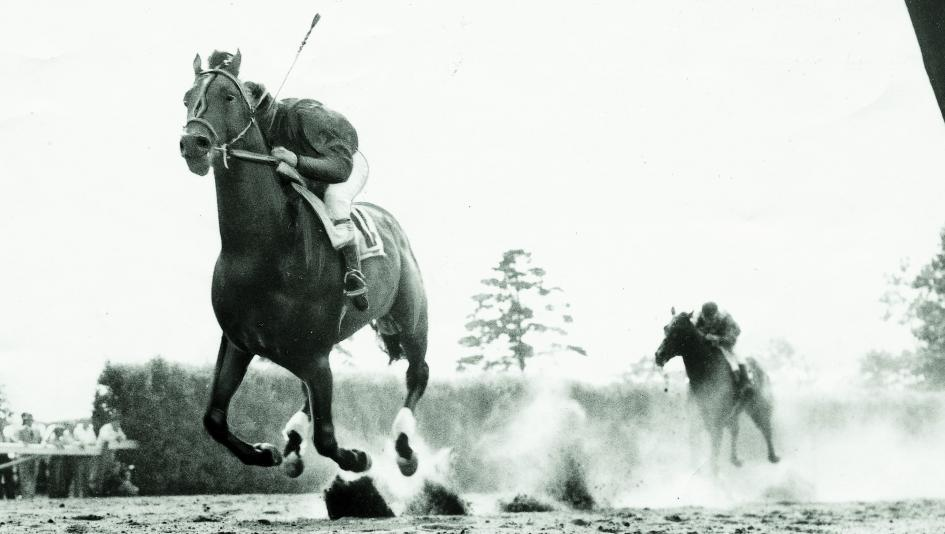 Citation wins the 1948 Belmont Stakes to sweep the Triple Crown.