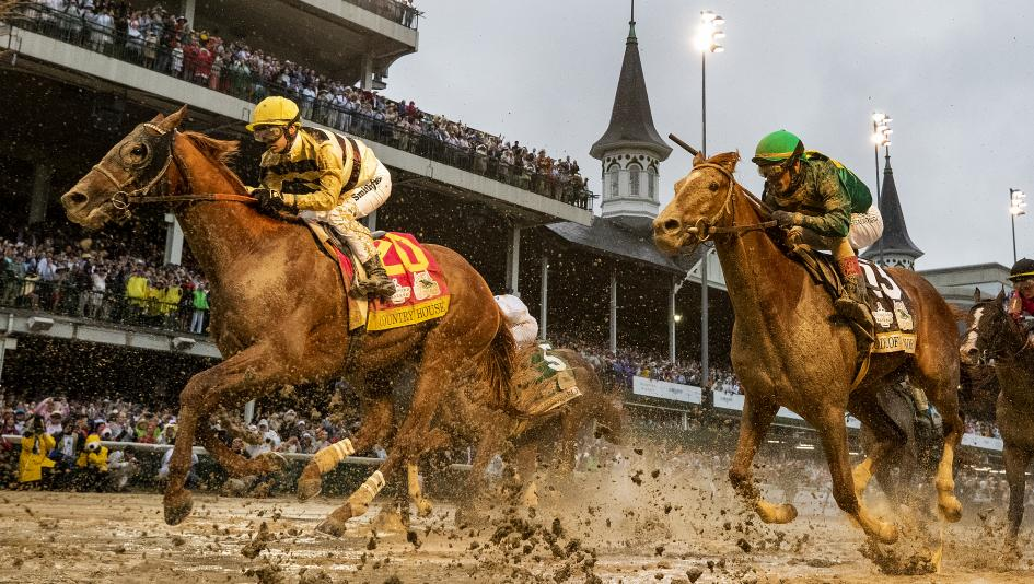 Country House strides through the slop at Churchill Downs to win the Kentucky Derby.