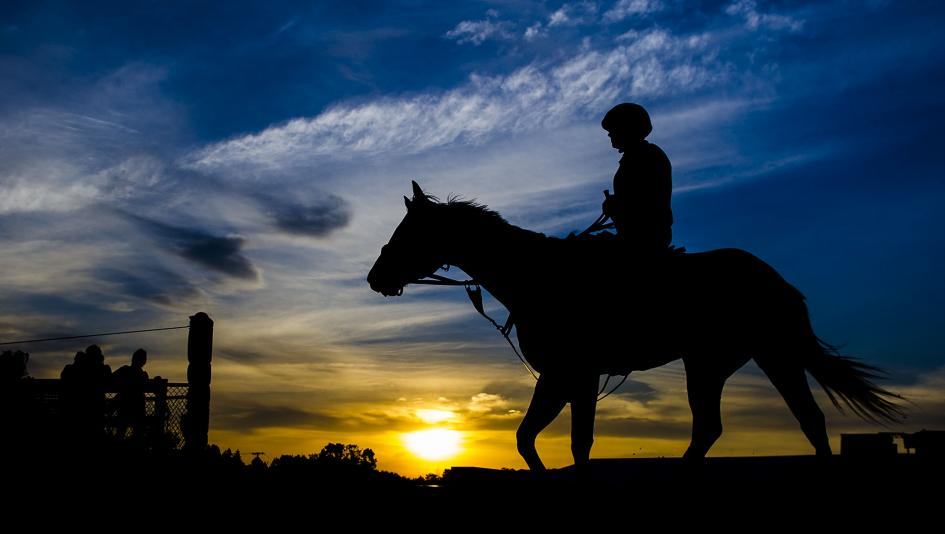 """""""Preakness Sunrise,"""" a photo by Eric Kalet, is one of dozens featured in the National Museum of Racing and Hall of Fame's photo exhibit."""