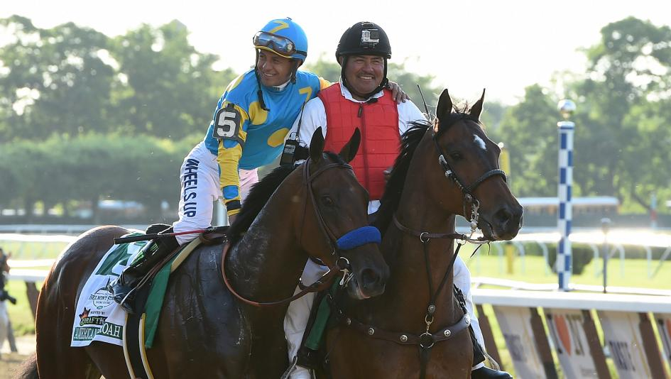 NYRA outrider Miguel Gutierrez escorted both American Pharoah and Justify to the winner's circle after their Triple Crown victories.