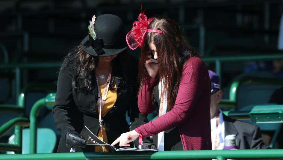 Racing fans look for a winner at Churchill Downs.