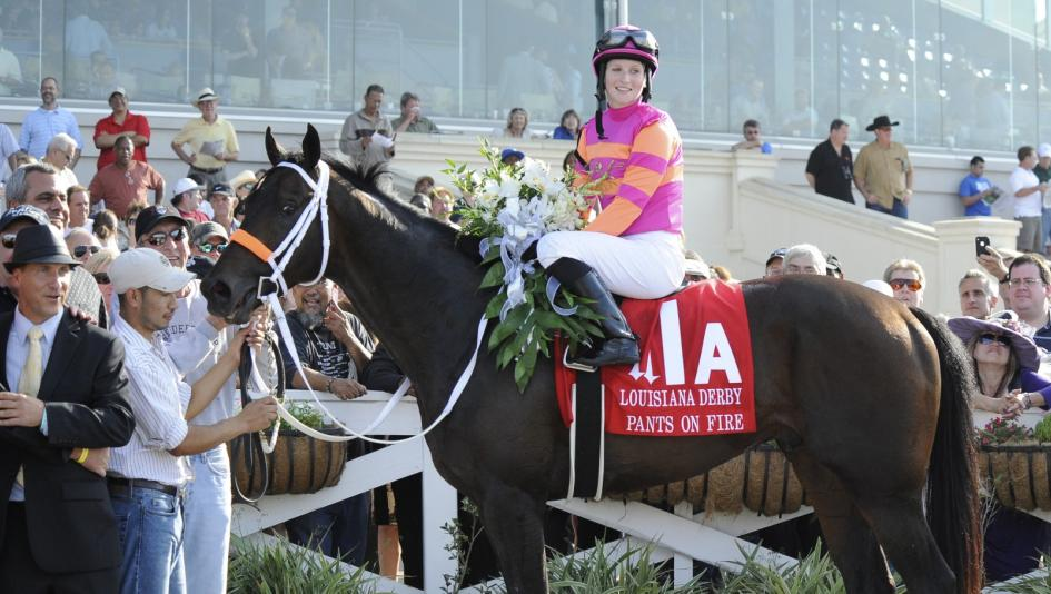 Two-time Louisiana Derby winning jockey Rosie Napravnik is pictured in the winner's circle with Pants On Fire in 2011. This year's Louisiana Derby is Saturday, March 23.