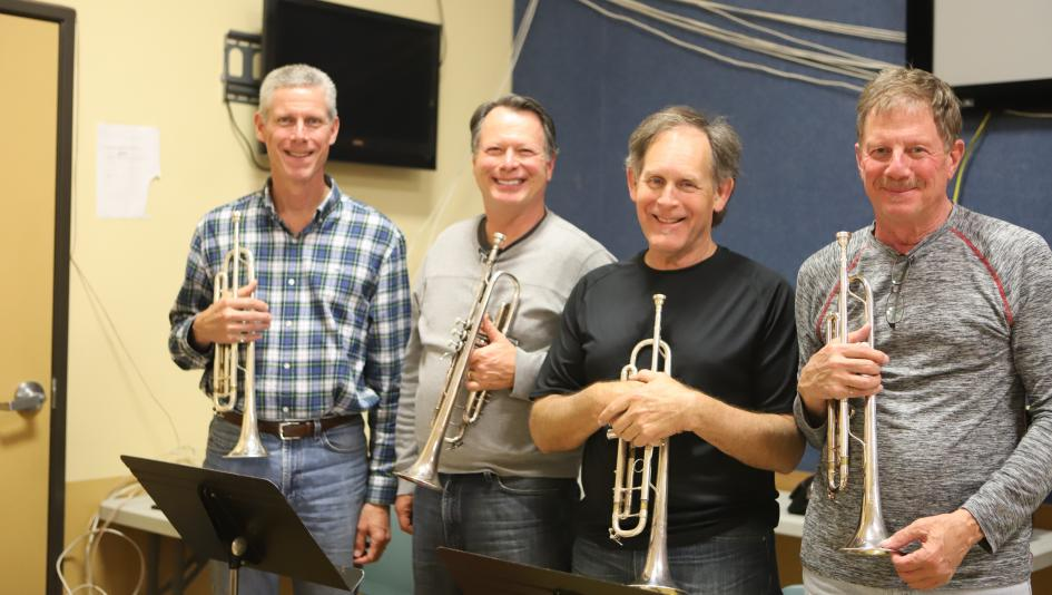 The Breeders' Cup trumpet quartet of Kevin Brown, Bill Frazier, Rick Tyree, and Santa Anita bugler Jay Cohen prepares to bring extra cheer to the crowd this weekend.