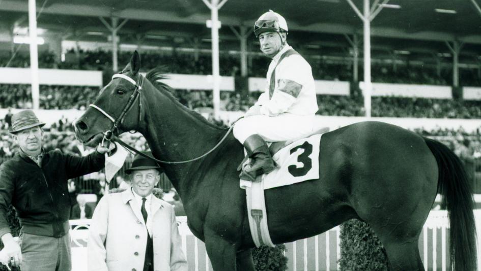 Johnny Longden, pictured in the winner's circle aboard Drill Site, is the only person to both train and ride a Kentucky Derby winner.