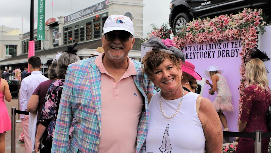 I love to wander through the crowds at the Kentucky Oaks and Derby to people-watch. I have a keen appreciation for fans who wear Derby-related clothing, equine jewelry, and whimsical hats. I noticed Libby Ludwig standing in line to have her photo taken at