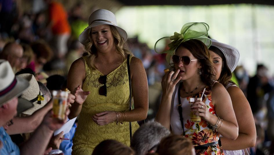 Fans enjoy the Preakness Stakes atmosphere at Pimlico.