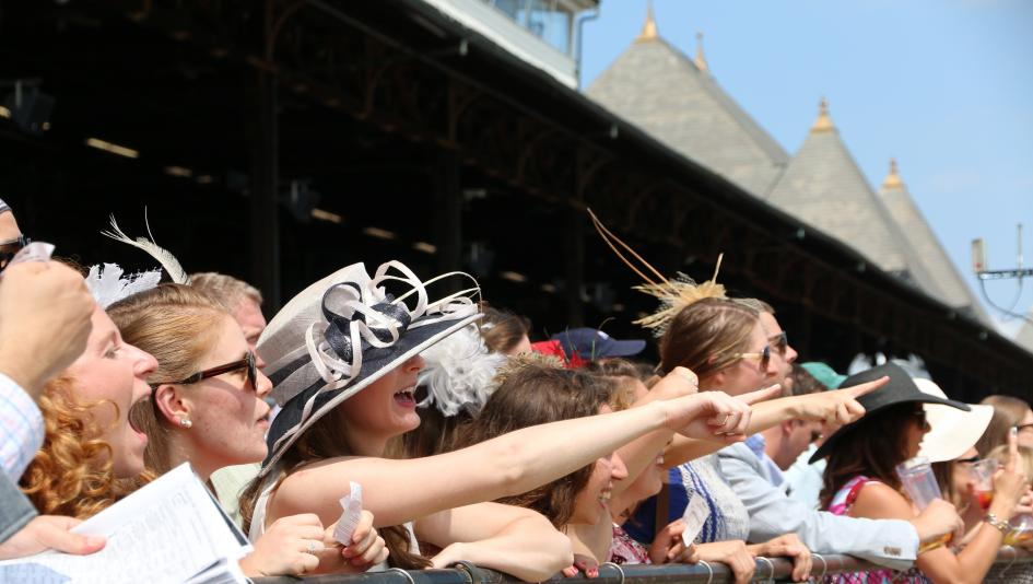 Fans crowd the rail at Saratoga Race Course, one of the most historic tracks in the U.S.