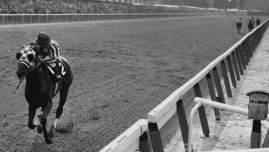 Secretariat wins the 1973 Belmont Stakes in an iconic performance.