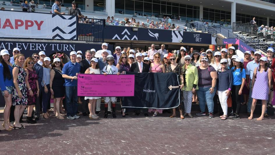 The Thoroughbred Aftercare Alliance and accredited organizations accept a check from Gulfstream Park.