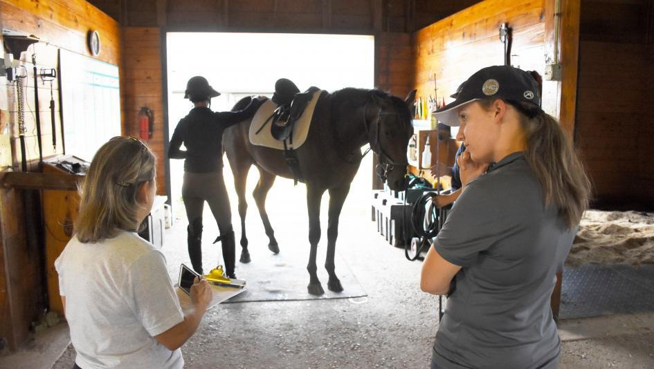 Suzie Oldham (left) inspects the Maker's Mark Secretariat Center for the Thoroughbred Aftercare Alliance.