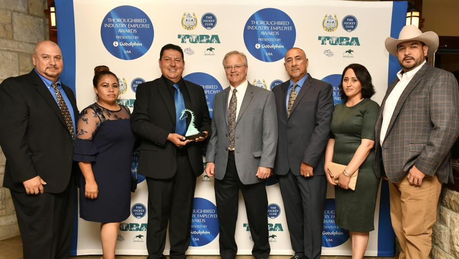 Saul Castellanos (second from left) received a Thoroughbred Industry Employee Award for Leadership in Racing in 2019