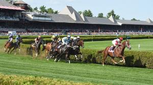 Horses race on the Saratoga turf.