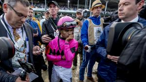 Maximum Security's Jockey Luis Saez awaits the stewards decision in the Kentucky Derby. They ultimately disqualified him to 17th.
