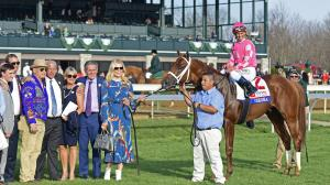 Derby hopeful Vekoma with his owners after winning the Blue Grass Stakes.