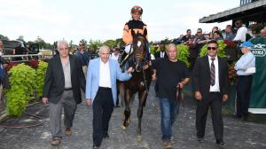 Imperial Hint is a once-in-a-lifetime horse for owner Ray Mamone (second from left) and trainer Luis Carvajal (far right).