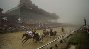 Justify captures a rainy, foggy edition of the Preakness Stakes at Pimlico.