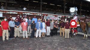 The members of Sackatoga Stable with Tiz the Law after winning the Runhappy Travers at Saratoga