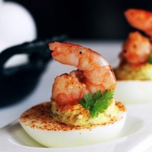 """<a href=""""http://bobbyflay.com/recipes/recipes/16/bar-americains-pickled-shrimp-deviled-eggs-with-cornichon-remoulade"""">4. Bar Americain's Pickled Shrimp Deviled Eggs with Cornichon Remoulade  </a>"""